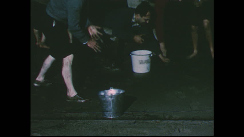 UNITED STATES 1950s: Close up of fish in bucket / Beach scene at night, people grab fish / Boys surrounded by beached fish / People grab fish, get hit by wave / Views of beached fish. | Shutterstock HD Video #8525014