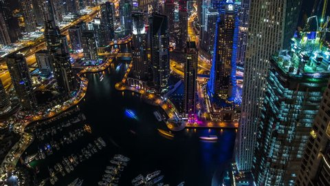 time lapse photography, aerial view Sheikh Zayed Road with Dubai Marina in United Arab Emirates at night, Photo Sequence shot in RAW, tilt