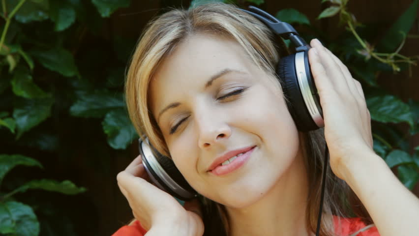 Young Woman Listens to Music  Stock Footage Video (100% Royalty-free)  856264   Shutterstock