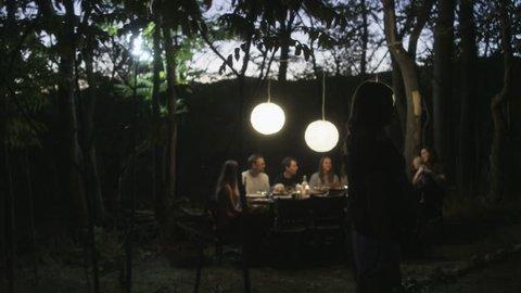 Friends enjoying outdoor dinner