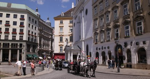 VIENNA, AUSTRIA - SEPTEMBER 15, 2014 Vienna Busy Streets Pebble Pavement Fiacres Pass Old Fashioned Transport Day ( Ultra High Definition, UltraHD, Ultra HD, UHD, 4K, 2160P, 4096x2160 )