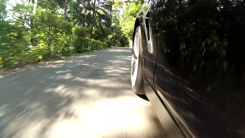 Low angle, car driving on a path