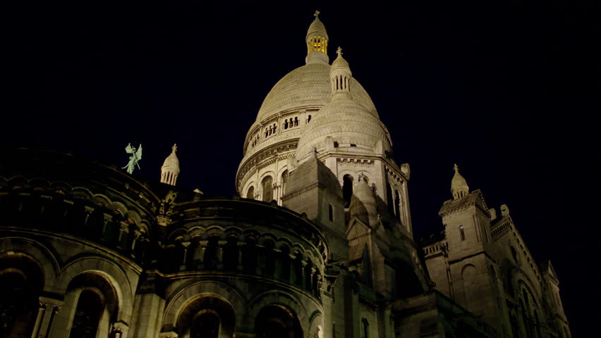 A tilt of the Sacred Heart Sacre Coeur Church in Montmartre, Paris, France at night. | Shutterstock HD Video #8626954