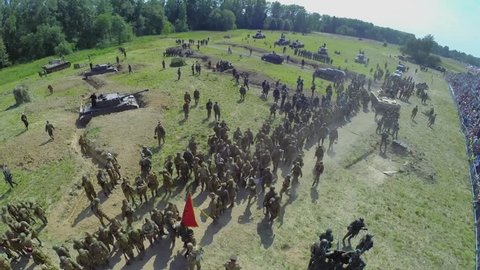 NELIDOVO - JUL 12, 2014: Troops of German and Soviet forces on field after fight during reconstruction Battlefield at summer day. Aerial view