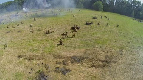 NELIDOVO - JUL 12, 2014: Soviet and German armies fight during reconstruction Battlefield at sunny day. Aerial view