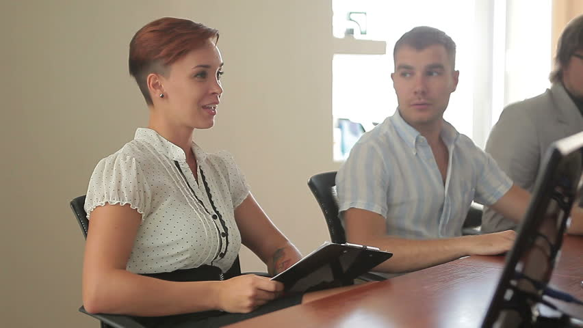 Young female caucasian team leader chairing boardroom meeting with successful business colleagues | Shutterstock HD Video #8654794