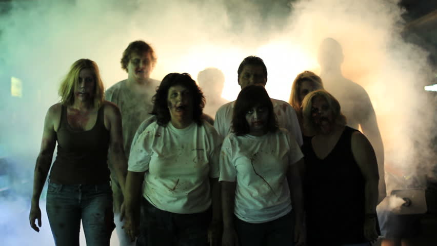 Unleashed hungry zombie horde stumbles through fog  | Shutterstock HD Video #8664574