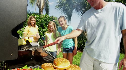 Food nutrition outdoor healthy eating BBQ grill social recreation togetherness Caucasian family mother father female children RED EPIC