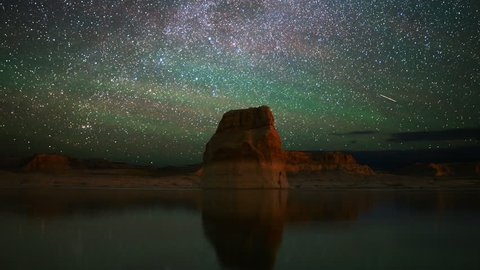 4K Astrophotography time lapse footage with zoom out motion of star trails over lone rock in Lake Powell, Glen Canyon National Recreation Area, Utah