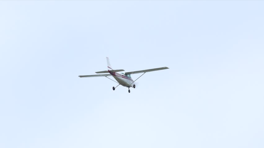 FORT LAUDERDALE - JANUARY 18: Video of a Cessna airplane in flight on a blue sky January 18, 2015 in Fort Lauderdale Florida USA.