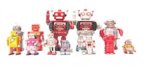 retro robot toys march into frame then walk of  4k film