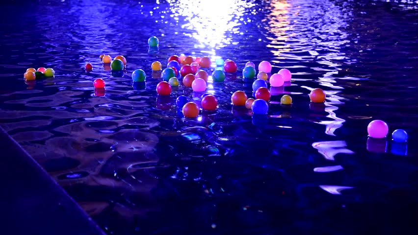 Stock Video Clip of Floating Balls on water in swimming pool