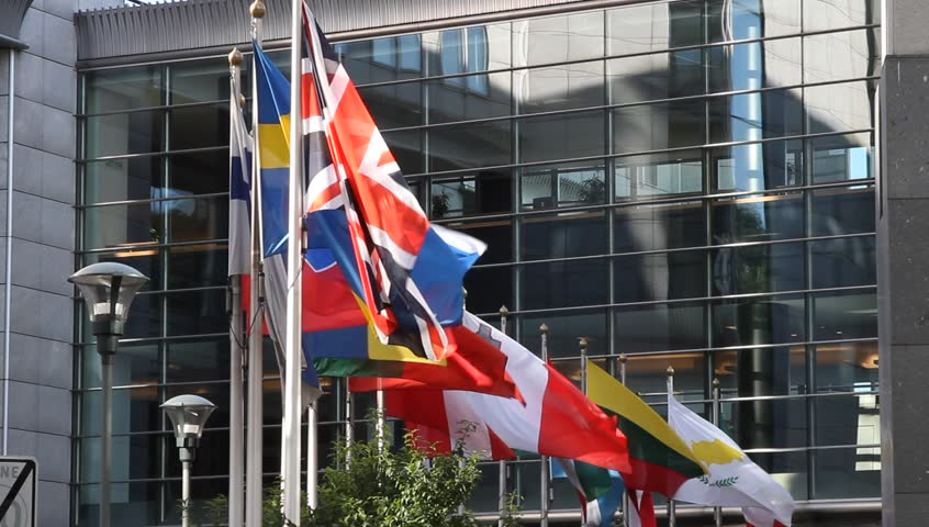 Flags of European Countries floating in front of the European Parliament building in Brussels