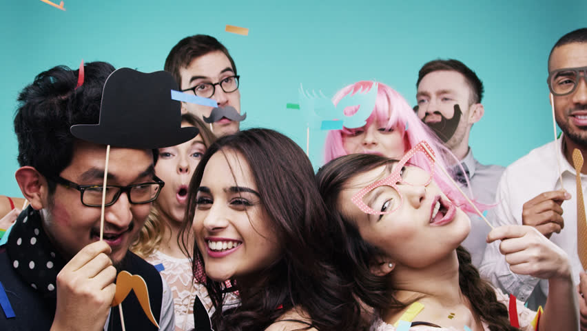 Multi racial group of funny people celebrating slow motion party photo booth Red Epic Dragon #8762884