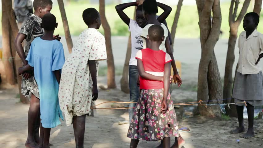 BOR, SOUTH SUDAN-NOVEMBER 5, 2013: Unidentified children play games in the village of Bor, South Sudan