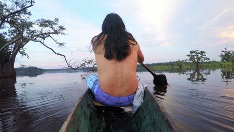 Indigenous Men On Wooden Canoe , On Board Camera , Shot From The Back Side Of Boat Against Beautiful Sunset