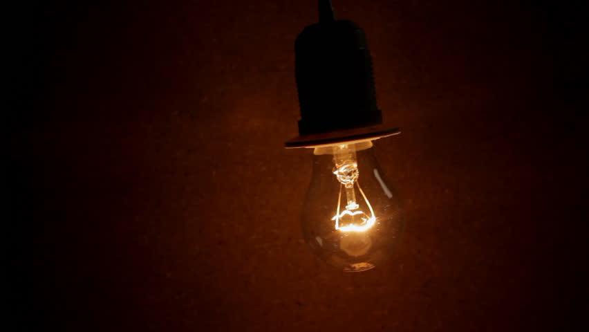 Light In Dark Room a light bulb illuminates a dark room, much like an idea in our