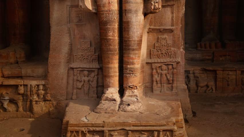 Rockcut statue of Jain thirthankara in rock niche near Gwalior fort. Gwalior, Madhya Pradesh, Indiaatue of Jain thirthankara in rock niches near Gwalior fort. Gwalior, Madhya Pradesh, India