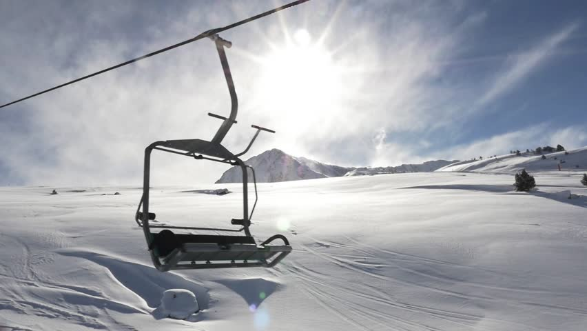 empty chair lift high speed empty chairlift in movement with the sun behind shutterstock hd video 8842744 ski lift royalty free