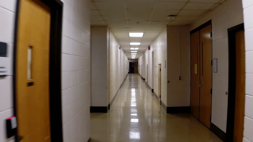 Point-of-View clip of walking down the empty hallway of a modern,