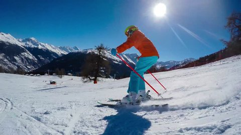 Skiing, winter, ski vacation - young girl skiing down, fun on mountainside