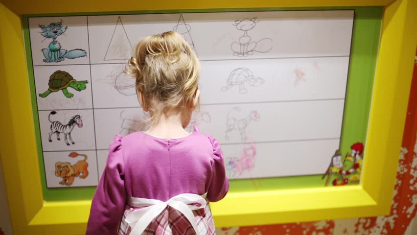 Young teacher using interactive whiteboard to display the world moscow russia nov 30 2013 little girl draws on board in mcdonalds gumiabroncs Gallery