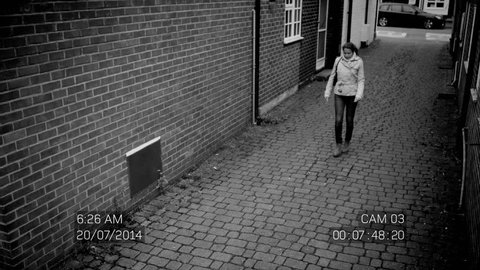 4K CCTV footage of woman in street being attacked by hooded thugs who steal her handbag