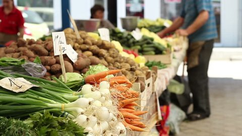 Green onions, carrots, potatoes, cucumbers and other vegetables of spring,  waiting for buyers in a traditional market for organic products