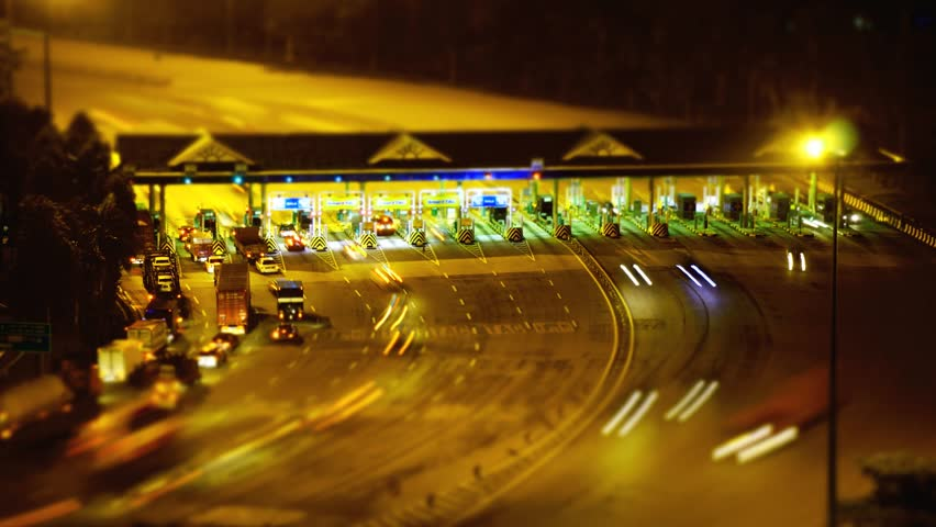 Vehicles queuing at Toll Plaza at Kuala Lumpur, Malaysia circa December 2014.