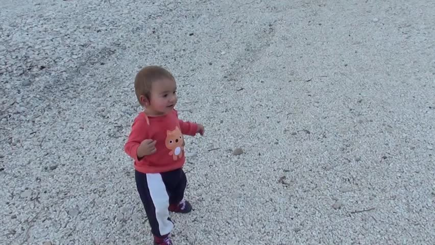 Baby does his first wobbly steps on gravels headingto a big fish