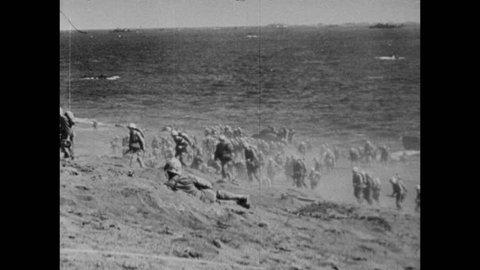 U.S. Marines arrive on beaches of Iwo Jima for Operation Detachment against Japanese Empire during World War II, Japan, circa February 1945