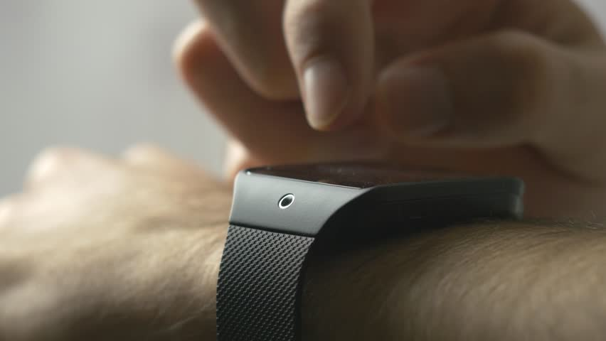 Making various gestures with a finger on a touch screen of a smart watch wearable device. | Shutterstock HD Video #8977633