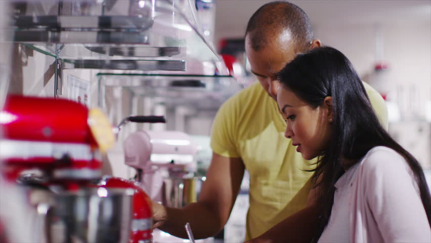 4K Couple shopping in a store selling kitchen appliances, white goods & electronics | Shutterstock HD Video #8983774