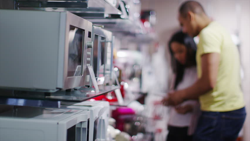 4K Couple Shopping In A Store Selling Kitchen Appliances, White ...