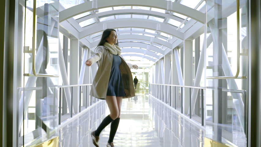 Carefree Mixed Race Teen Dances And Spins Around Inside A Skybridge