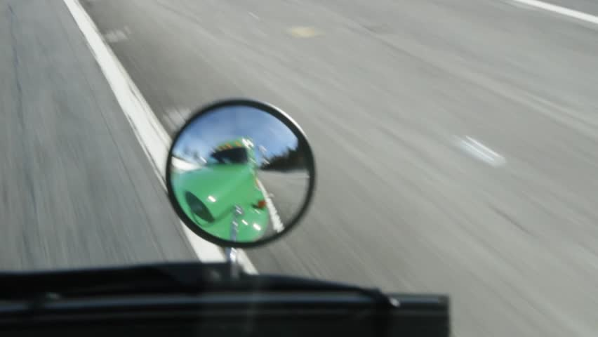 Pov of a truck on highway looking into mirror   Shutterstock HD Video #900634
