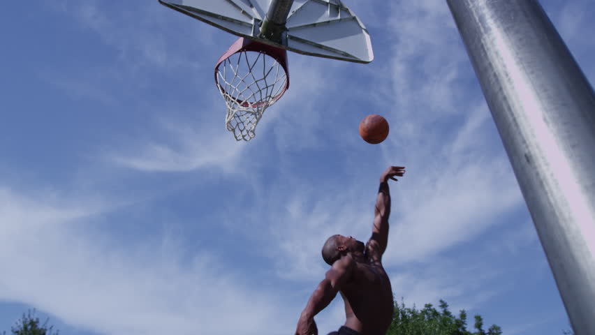 One on one street basketball; player is blocked | Shutterstock HD Video #9032380