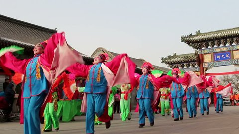 Feb,22,2015-Tianjin,China: Local villagers are dancing yangko in spring festival temple fair held in Dule temple, which is a historical Buddhist temple dated back at least to the early Tang Dynasty.