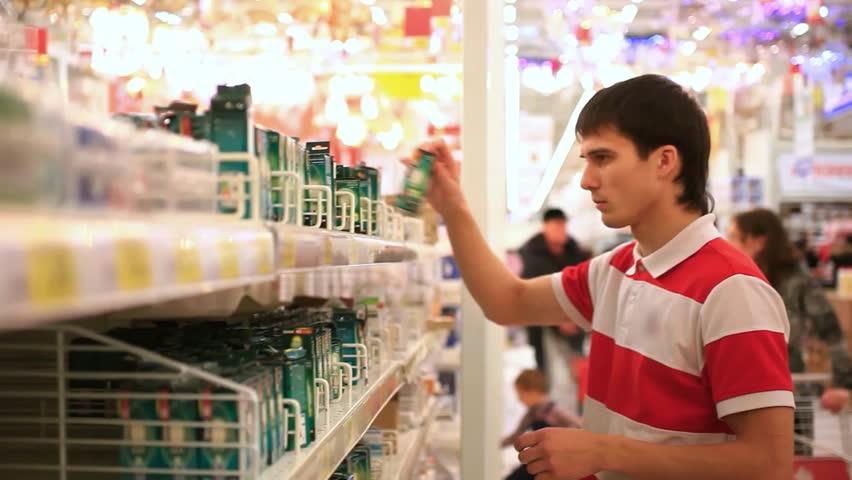 Man shopping in supermarket , choose a light bulb. HD. 1920x1080   Shutterstock HD Video #9150164