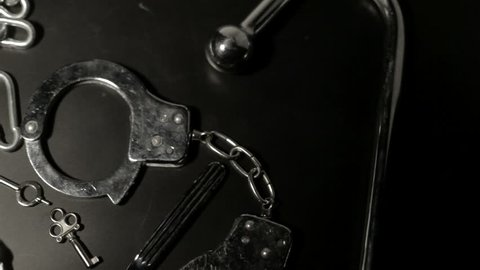 BDSM tools on black table