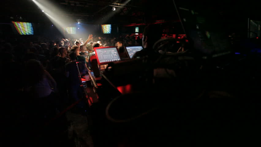 wide view of vj and light mixer on dance-floor