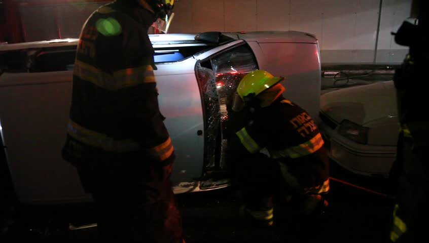 haifa israel march 03 2015 firefighters remove the front glass from car - Glass Front Cafe 2015