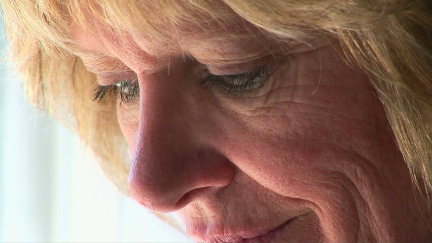 Closeup portrait of mature woman feeling stressed