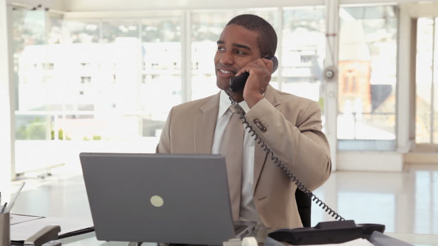 Businessman Using a Phone at the Office