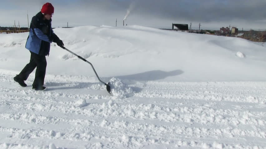 Man shoveling snow from the road  | Shutterstock HD Video #9224114