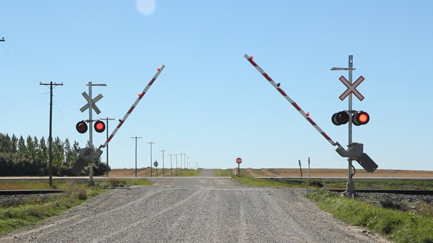Rail crossing with sound of train coming. Gates lowering. Rail crossing with sound of freight train coming. Kemnay, Manitoba.  | Shutterstock HD Video #9235517