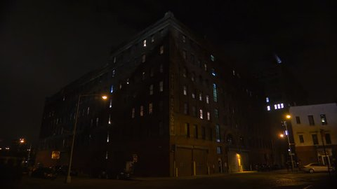 NEW YORK CITY - CIRCA 2015 - Wide shot of a New York or Brooklyn apartment complex in a warehouse district at night.