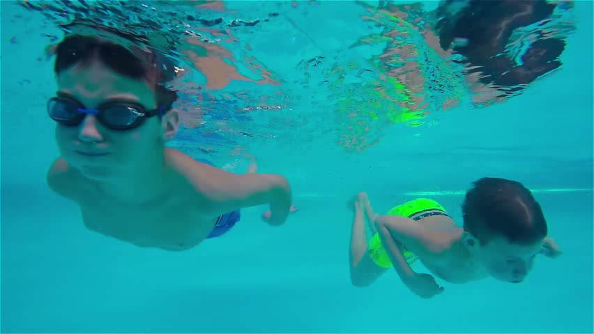 9ecd32e45720c Teen Boys Swimming Underwater in Stock Footage Video (100 ...