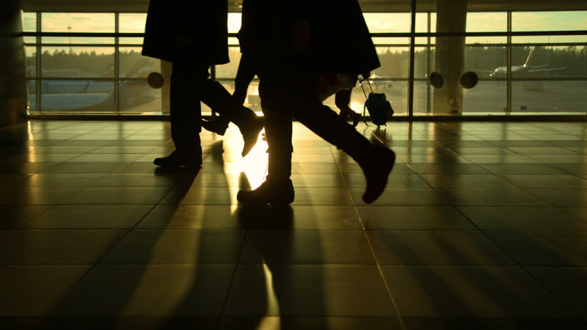 Moscow, March 2015, the crowd moves in airport, silhouettes