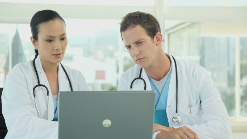 Medical Professionals Using a Laptop